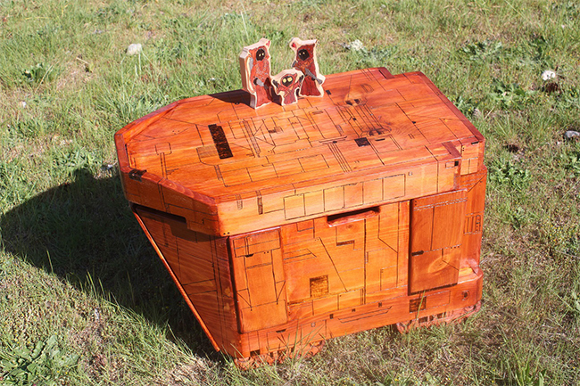 I was commissioned to make a basic Jawa Sandcrawler toy chest, but I went a bit wild. If you look on top, you can see I integrated Jedi's name into the design of the paneling.